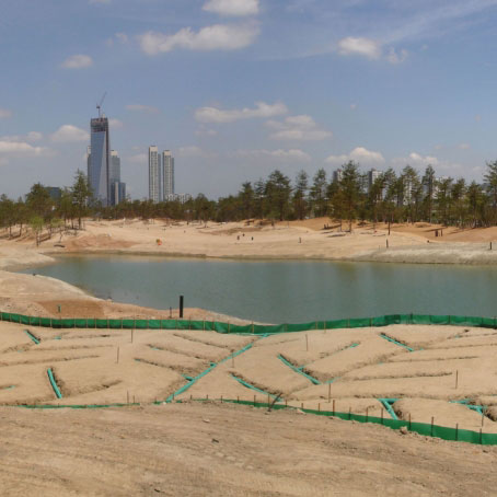 A golf course without grass and drainage channels shown