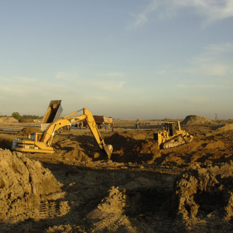 Excavation equipment working on a landscape
