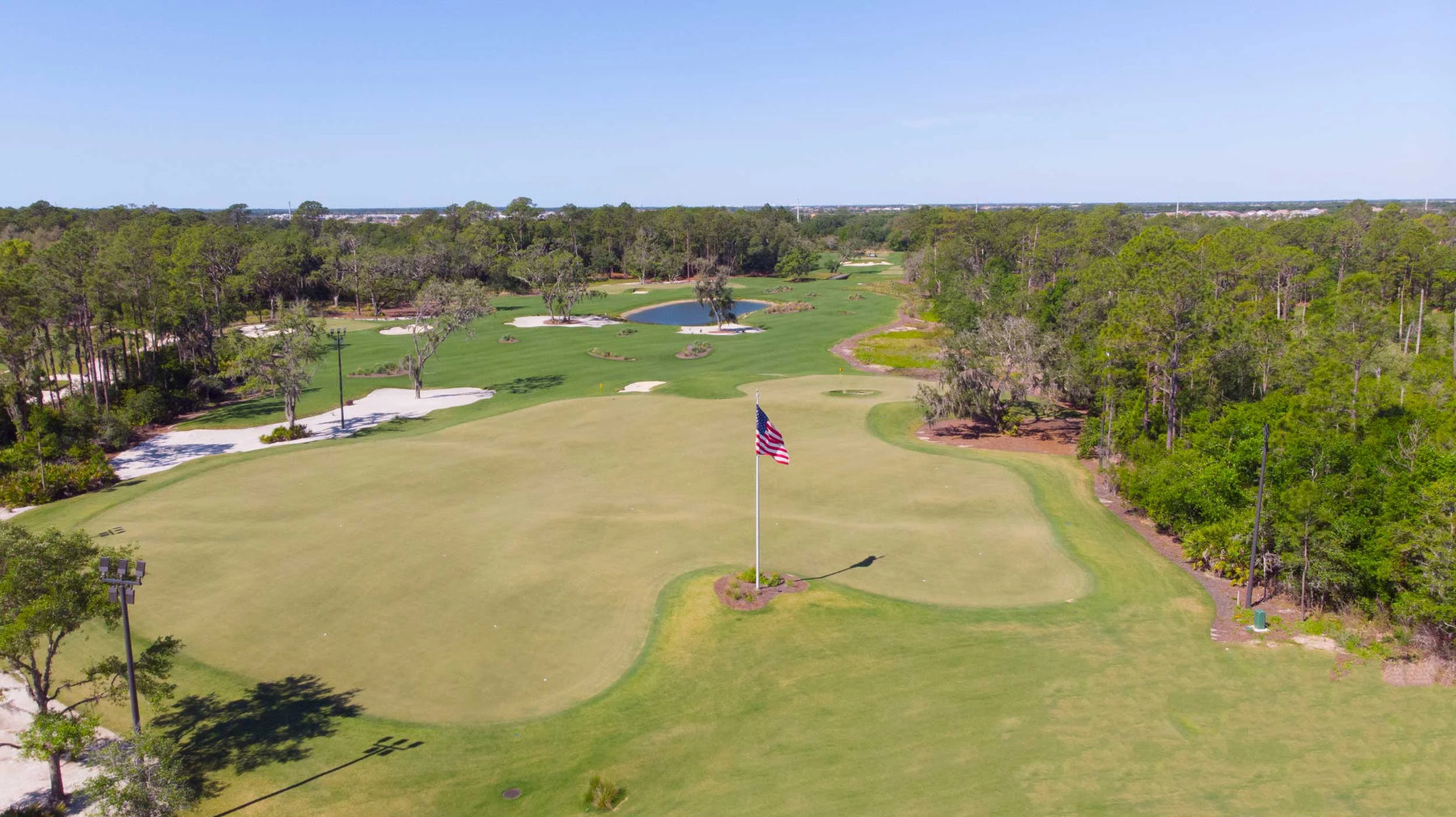 The one-acre putting course at Concession with the par-3 course beyond it.